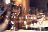 Close up picture of empty glasses in restaurant. Selective focus — Stock Photo