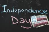 Black chalkboard in classroom with flag of us...Independence Day — Stock Photo