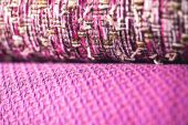 Rolls of colorful fabric as a vibrant background image — Stock Photo