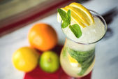 Fresh green lime soft lemonade in a glass on wooden table with decorations. Selective focus — Stock Photo
