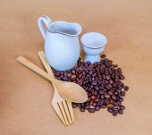 Coffee bean and white mug — Stock Photo