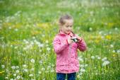 Little girl photographing with her camera — Stock Photo