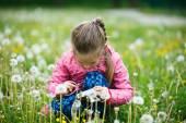 Girl checking photos she made with digital camera — Stock Photo