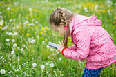 Little girl photographing with her smartphone — Stock Photo