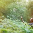 Geocaching in sunlit forest — Stock Photo #73644895