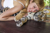 Woman and tiger — Stock Photo