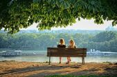 Two Women Sitting On Bench In Front Danube Rivers, Belgrade — Stock Photo