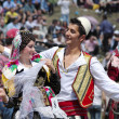 Young couple in albanian costume performs a courtship dance in Lepushe, commune of Kelmend — Stock Photo #73248847