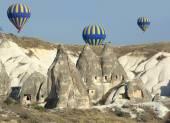 Balloon Over Rock Cave Houses, Cappadocia — Stock Photo