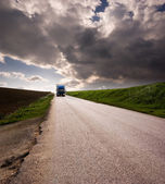 Landscape for truck on road and stormy sky — Stock Photo