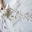 Word gluten crossed out on wood board with flour — Stock Photo #76194753