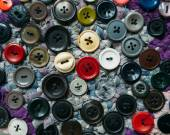 Old buttons sewn — Stock Photo