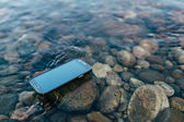 Lost smartphone on the water — Stock Photo