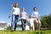 Happy family running — Stock Photo