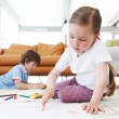 Brother and sister drawing pictures — Stock Photo #78966704