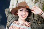Bright stylish lifestyle portrait of pretty girl posing at hat. — Stock Photo