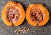 Ripe orange pumpkin on burlap background — Stock Photo