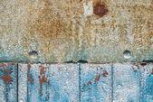 Door of planks reinforced sheet of rusty metal background — Stock Photo