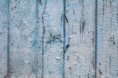 Chipped paint on the door of the old boards texture background — Stock Photo