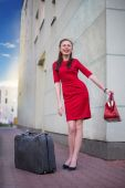 Girl with gray vintage valise — Stock Photo
