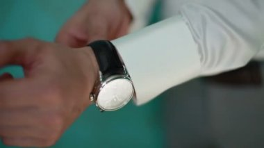 A man arranging his watch — Stock Video