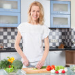 Young Woman Cooking. Healthy Food - Vegetable Salad. — Stock Photo #75803651