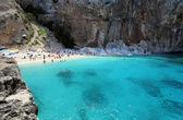 Cala Mariolu, Italy - July, 1st 2015 People on one of the beautiful beach in Sardinia — Stock Photo