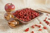 Goji beans on wooden cup — Foto Stock
