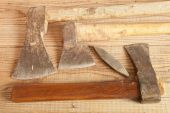 Three dated and used cleavers on wooden background, country style — Stock Photo