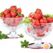 Lots of strawberries in two glass bowls over white. — Stock Photo #75625179