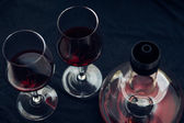 Glasses of wine and decanter — Stock Photo