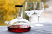 Wine decanter and empty glasses — Stock Photo