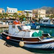 Colorful wooden boats in cosy Greek port — Stock Photo #72601991