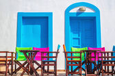 Colorful Greek restaurant table and chairs, Greece — Stock Photo