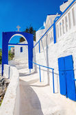 Greek church with iconic blue and white stairs — Stock Photo