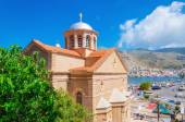 Greek church with red roof and city port — Stock Photo