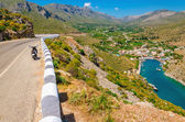Vathi bay, lowland and scooter standing, Greece — Stock Photo