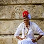 Old black lady smoking a cuban cigar — Stock Photo #72833839