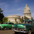 Green cars rides in front of the Capitol — Stock Photo #72835509