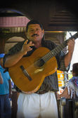 Cuban man playing and singing — Stock Photo