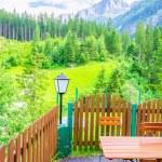 Exterior restaurant and green alpine meadows — Stock Photo #72843119