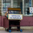 Постер, плакат: Stand with the repair of glasses Havana Cuba