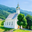 Beautiful alpine landscape with church, Austria — Stock Photo #73119739