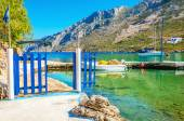Small port with boat and blue gate, Greece — Foto de Stock