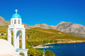 Typical Greek church with blue dome and sea Greece — Stock Photo
