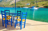 Wooden blue chairs in Greek restaurant, Greece — Stock Photo