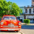 Постер, плакат: Classic American red car on street of Havana Cuba