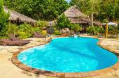 Beautiful swimming pool close to exotic beach — Stock Photo
