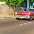 Classic American red car in Havana, Cuba — Stock Photo #73802879