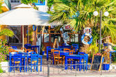 Blue wooden tables in Greek restaurant  — Stock Photo